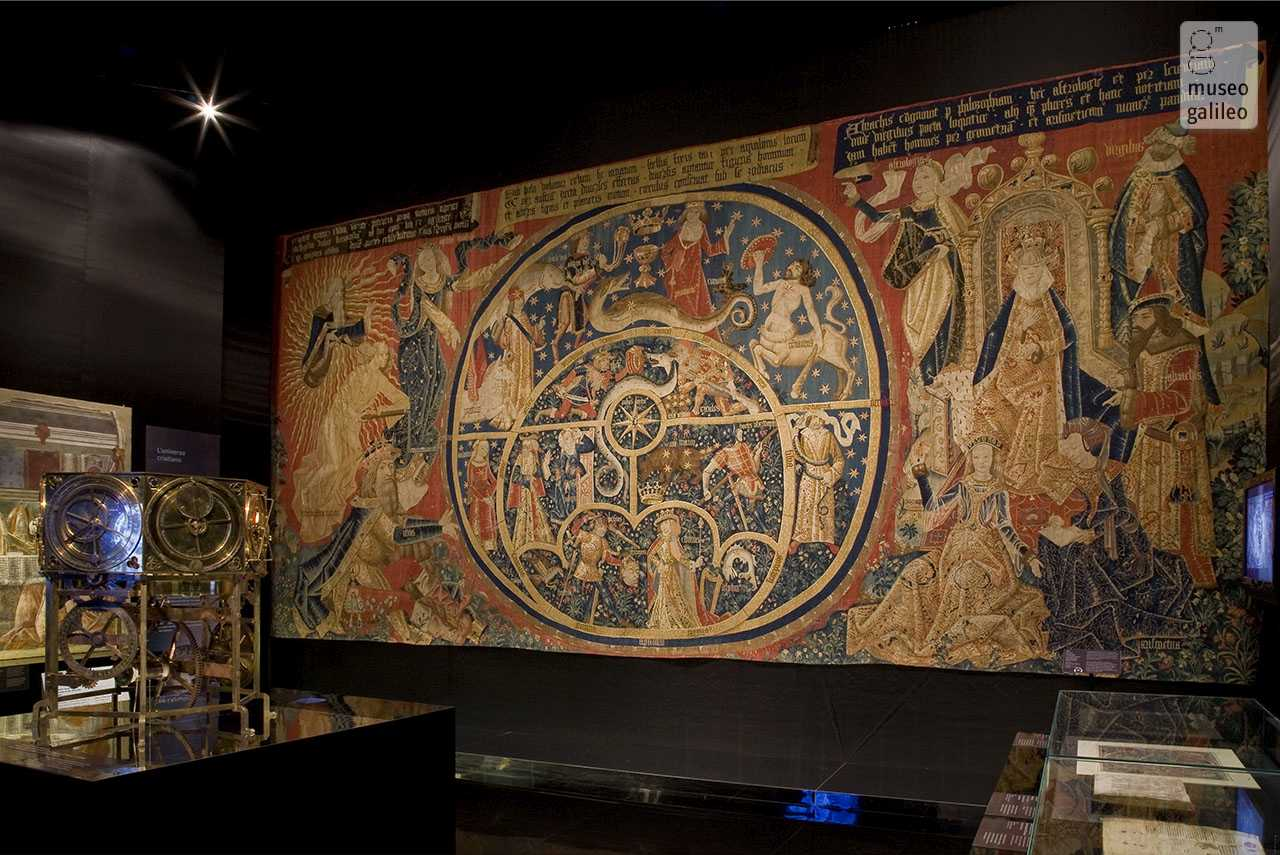 "Galileo: Images of the Universe from Antiquity to the Telescope. Section V, Evangelisation of the cosmos: in the foreground, the wonderful tapestry ""The movements of the universe"" (1450-1500), Florence"