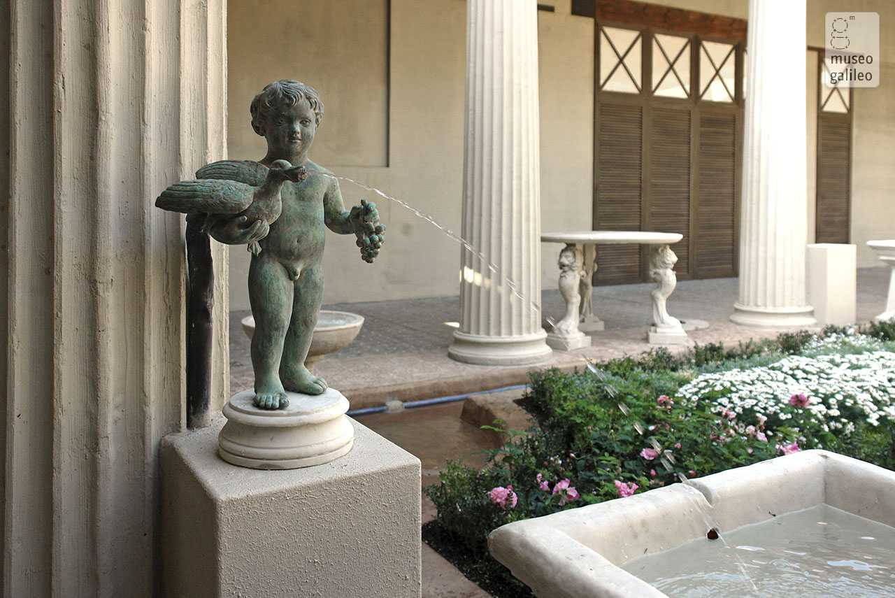 Ancient Gardens from Babylon to Rome.   Cupid with duck and cluster of grapes in the life-size reconstruction of the Pompeian garden of the House of the Vettii, Florence, Boboli Gardens