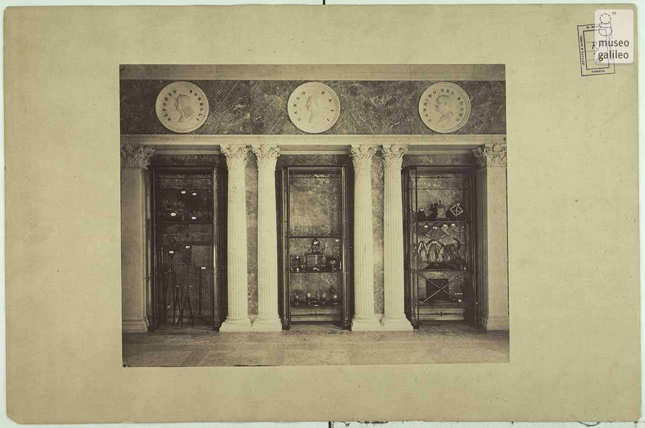 Showcases of the Tribune of Galileo containing various thermometers of the Accademia del Cimento, topographic instruments and other scientific instruments. Historical photo